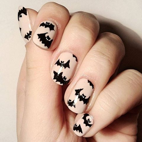 """We've gone batty for this festive Halloween look! Do it yourself with """"My Vampire Is Buff,"""" """"Black Onyx,"""" and a nail art brush!"""