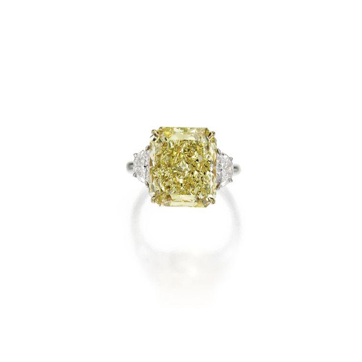 Platinum, 18 karat gold, fancy yellow diamond and diamond ring