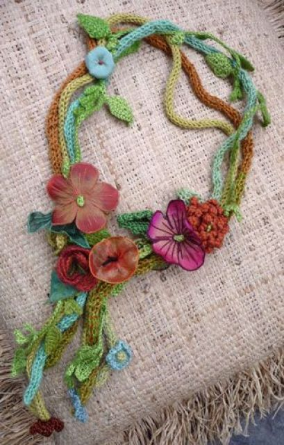 Could do French knitting for cords and knitted small leaves, plus chiffon sewn flowers and butterflies