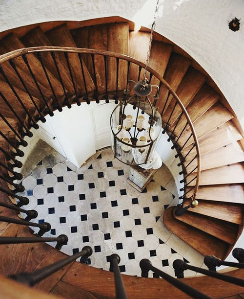 black and white floor tile and circular staircase // foyer design
