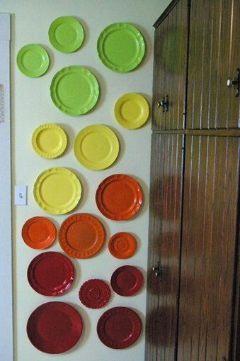 Get any old plates at a thrift store, spray paint them in a rainbow of colors, and hang them with invisible hangers! You've made a rainbow inside your home! by marian