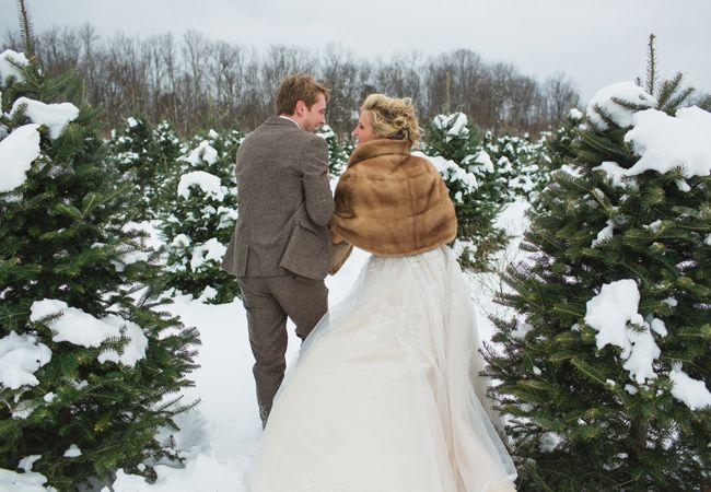 Winter bride & groom portrait ideas // Lauren Fair photography // http://blog.theknot.com/2013/12/16/a-cozy-and-glitzy-winter-wedding/