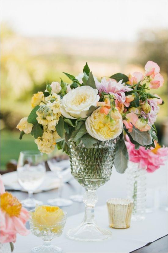 spring floral wedding arrangement #weddingreception #weddingflorals #weddingchicks http://www.weddingchicks.com/2014/02/28/soft-summer-vineyard-wedding/