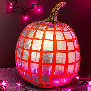 Get your Halloween party started with a mirror-ball pumpkin. Lay strips of metallic silver duct tape onto parchment paper, then cut the tape into squares. Peel off the backing and stick the squares in place. For greater realism, use smaller squares near the top and bottom of the pumpkin, as shown.