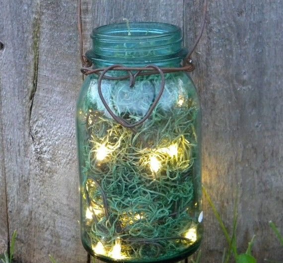 Another interesting take on the Mason jar idea... no fire required, just battery powered lights and flower moss. How cute is this? SMF will be doing this. We love fireflies.