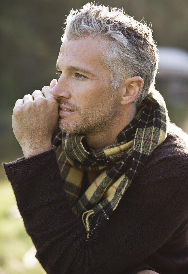 Black & yellow men's scarf. Salt & pepper hair & stubble facial hair. Michael Justin, really makes older gentlemen look great.