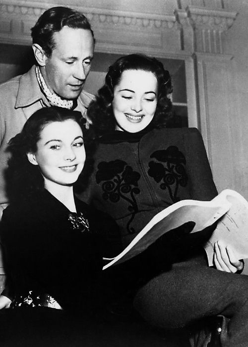 Vivien Leigh, Leslie Howard, and Olivia de Havilland look over a script for Gone With the Wind