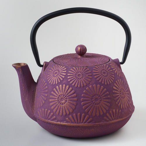 One of my favorite discoveries at WorldMarket.com: Plum Flower Cast Iron Teapot