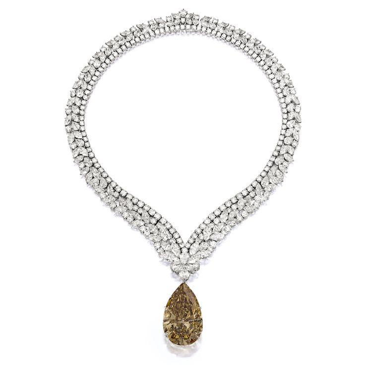 Impressive Fancy Deep Brown-Orange Diamond Pendant; with Diamond Necklace, Cartier   Lot   Sotheby's