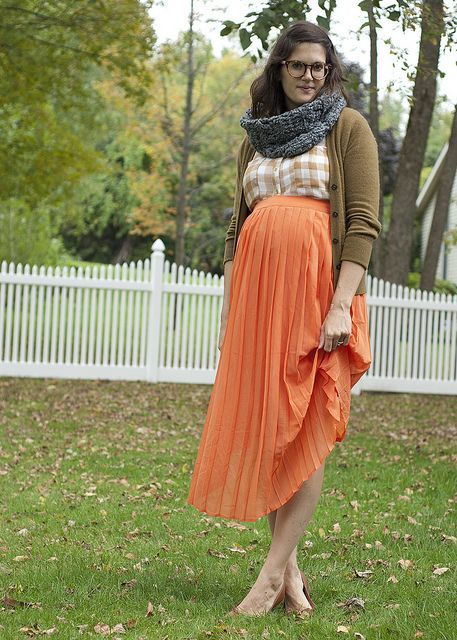 Fall Hues  Plaid is something we all love wearing for fall. Layer it with a great cardigan for chilly days and accessorize with a warm and cozy cowl scarf in a pop of color. Pull it all together with a bright chiffon skirt!