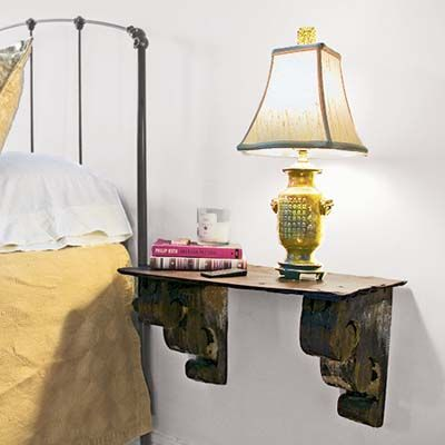 Handsome--and affordable--bedside table made of wood corbels topped by a slate roof shingle. | Photo: Cressida Payavis | thisoldhouse.com