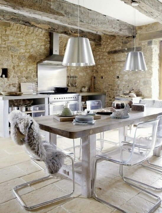 Mix of traditional and contemporary - Stone wall, stainless steel, exposed beams