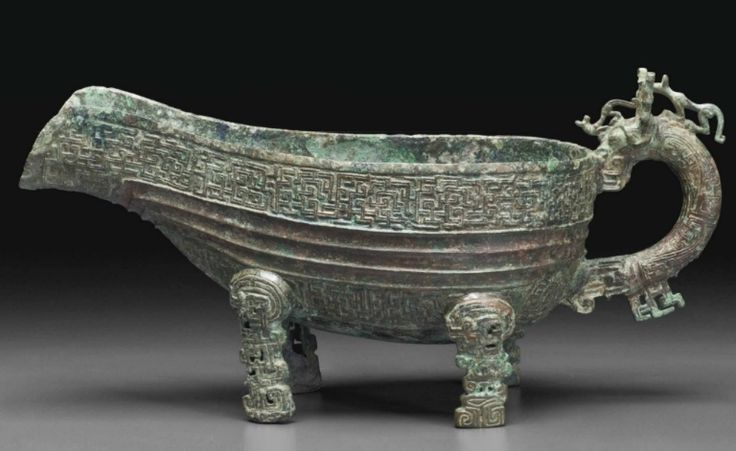A very rare bronze ritual pouring vessel, yi, Spring and Autumn Period, 7th century BC
