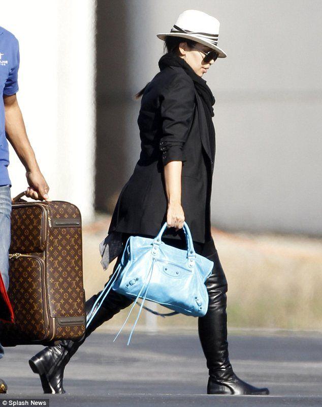 Kim Kardashian in thigh high leather boots & a balenciaga bag