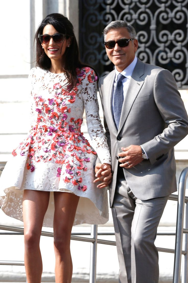 Newlywed couple, George and Amal Clooney, appear together for the first time, the day after their ceremony in Venice.
