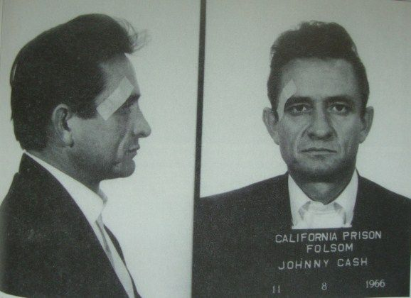 "In his book, ""Folsom Prison"", Jim Brown explains that Johnny Cash had this mock mug shot taken as a joke.  Brown notes that the bandage is presumably designed to make people think guards roughed the singer up a bit. Saul Holiff, son of Cash's one-time manager, Jonathan Holiff, donated this ""mug shot"" to the Folsom Prison Museum in 2007."