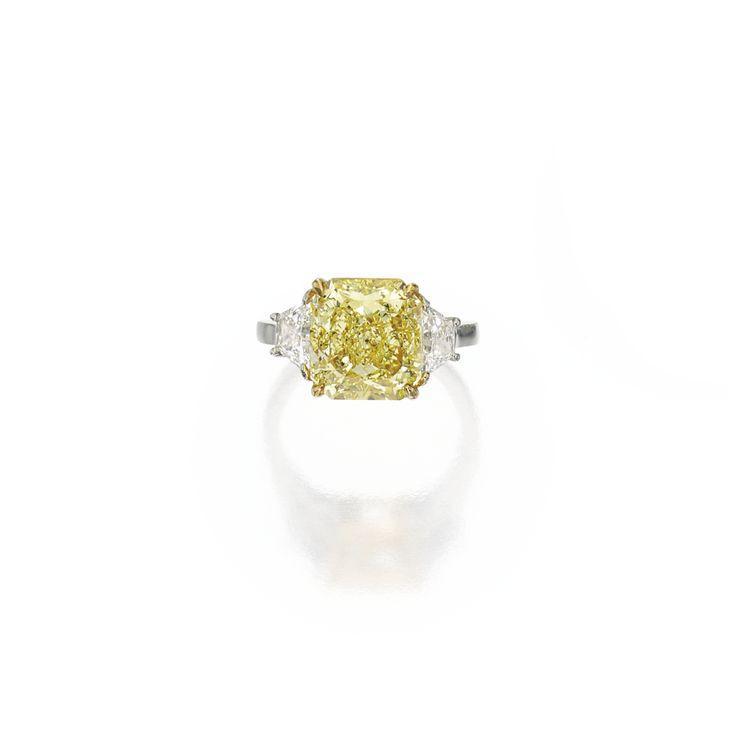 Platinum, 18 karat gold, fancy intense yellow diamond and diamond ring