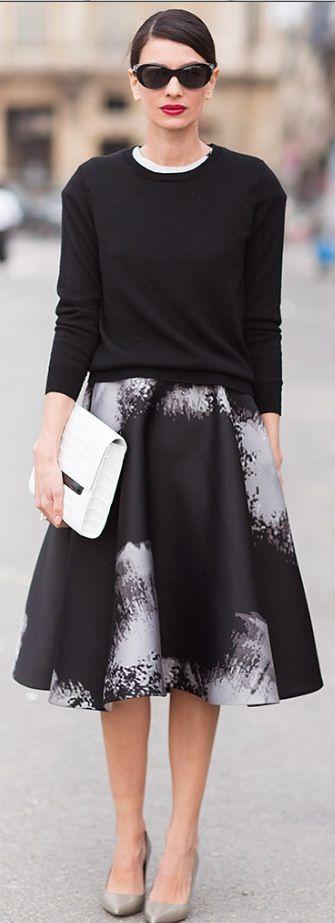 Street Style - Leila Yavary black sweater / black & white print skirt / white clutch