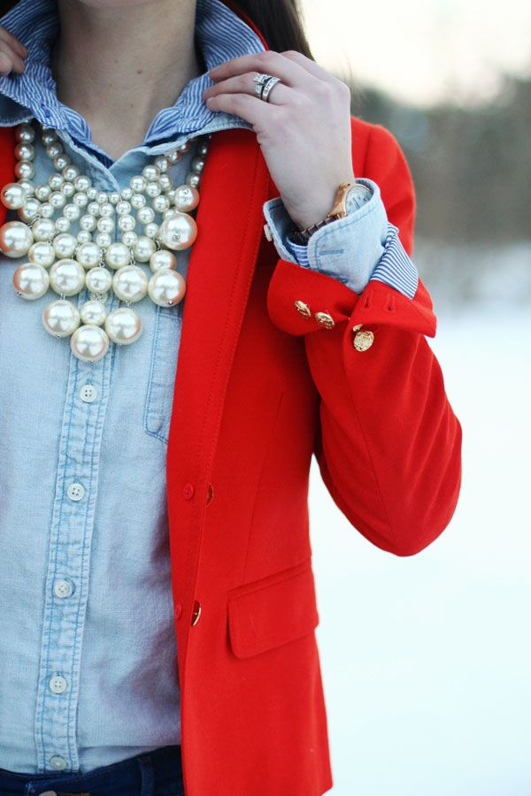 Chambray, red blazer, pearl statement necklace.