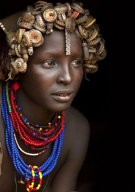 Dassanech girl with caps wig - Omorate Ethiopia...