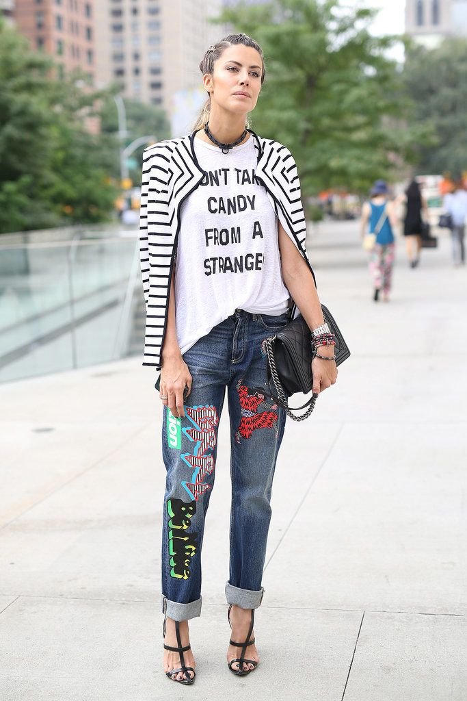 Best #streetstyle @ Spring 2015 Ready-to-Wear #NYFW | a striped cardigan over a white graphic print muscle t-shirt paired with boyfriend jeans with graffiti designs, black strappy heels and a matching Chanel bag
