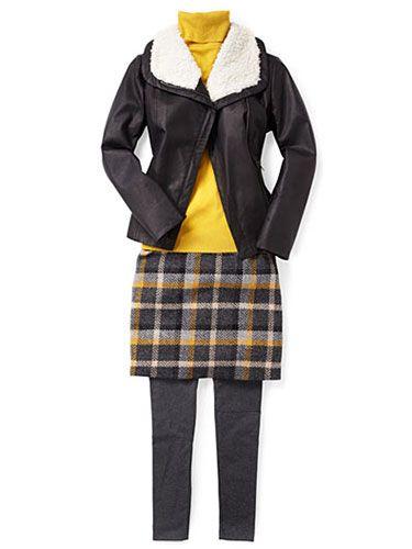 Play up the skirt's plaid checks with gunmetal leggings.