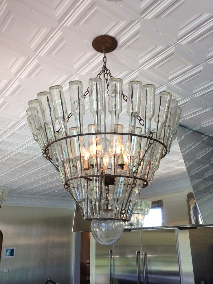 The kitchen chandelier is made from upcycled bottles! #HouseofRock #SilestoneTrends