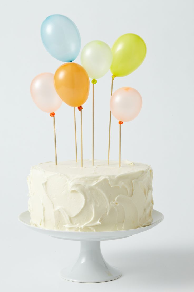Water balloons on skewers for an instantly lovely cake topper!