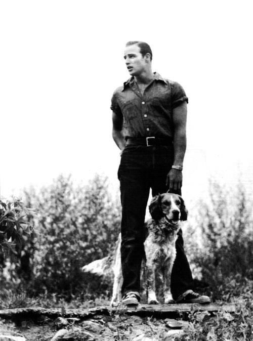 Marlon Brando with family dog, Illinois, early 1950s.