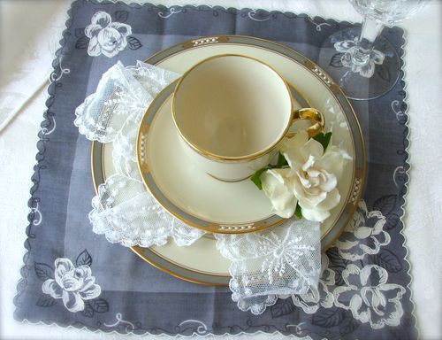use vintage handkerchiefs as placemats and napkins