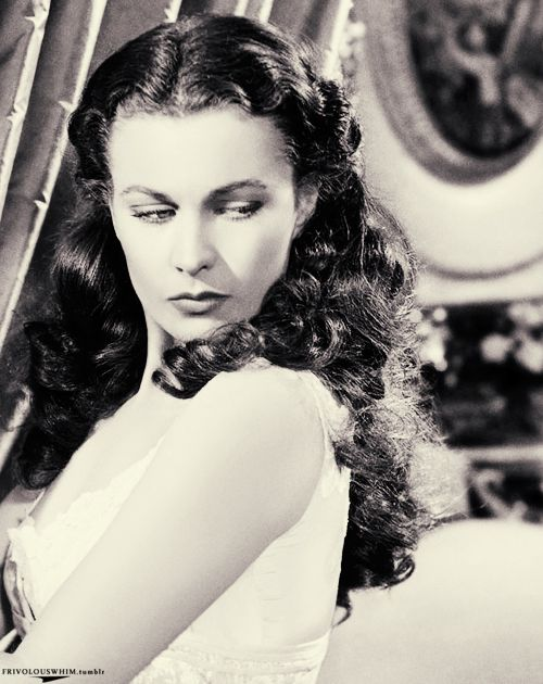 "Vivien Leigh as Scarlett O'Hara getting fitted into her corset in ""Gone with the Wind"" (1939)"