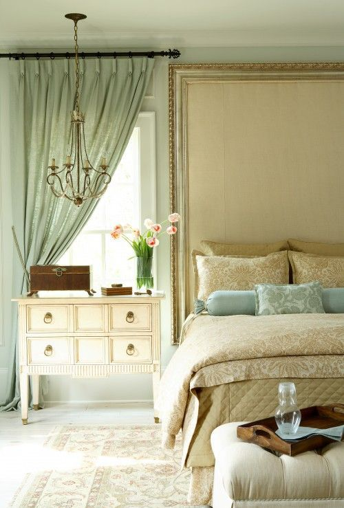 Sea spray, tall headboard, dresser as a nightstand, chandelier as bedside lighting, pinch pleat drapes