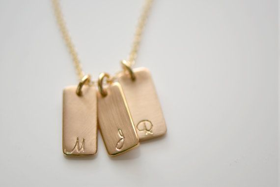 Little gold bars bear the initials that mean the most.