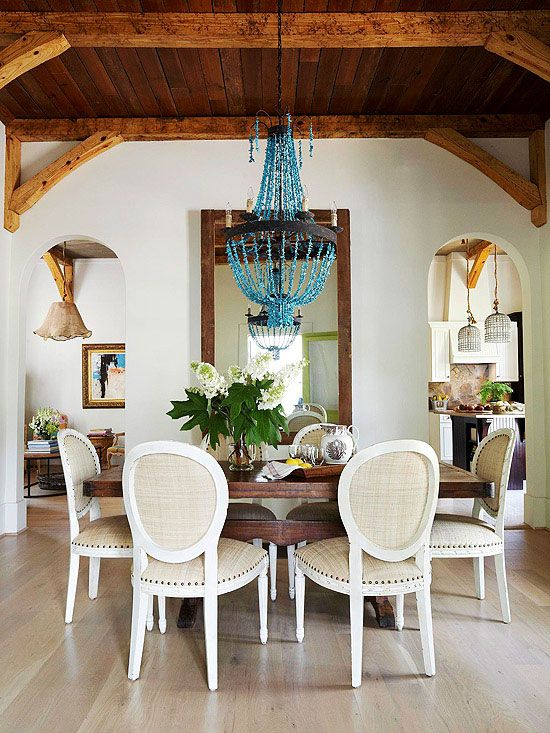 Hang Beams Overhead - Rough-hewn ceiling beams (even faux ones) lend old-world charm to any room. Try them in your common areas.