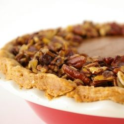 Classic pumpkin pie with a glazed pecan, almond, and Pepita topping.
