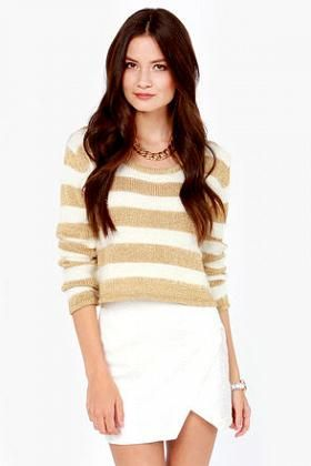 Alternating bands of soft ivory eyelash knit and metallic gold make a killer combo down this cropped, box-cut sweater. Scoop neckline is trimmed in gold.