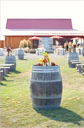 Wine barrels as outdoor barn wedding decor