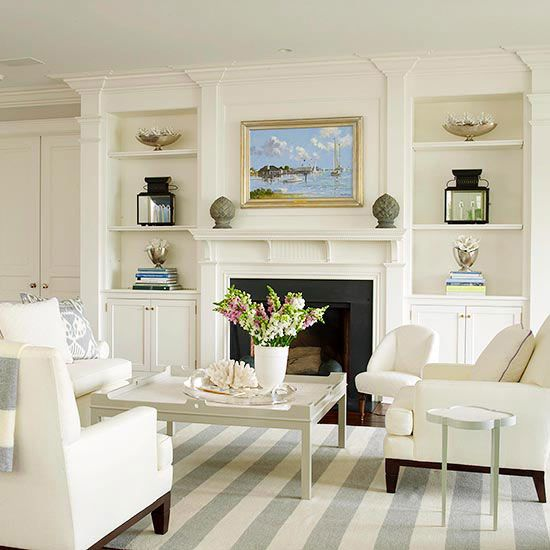 Built-In Structure - Built-in shelving units surrounding a fireplace make the components read as one, creating an eye-catching focal point for this living room. The symmetrical arrangements on the shelves draw attention to the fireplace in the center. A black frame around the firebox accentuates the fireplace even more.