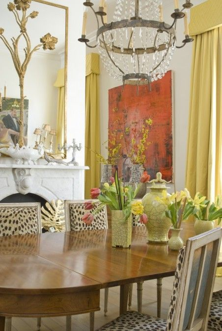leopard chairs and yellow drapes