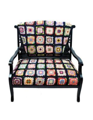 You know you have seen tons of these afghans at our sales - how cool to upholster a chair with one!