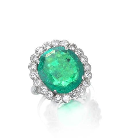 An emerald and diamond cluster ring, circa 1935