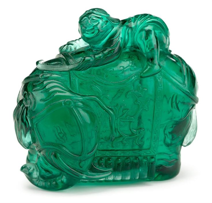 Chinese translucent green glass 'boy on elephant' carving, Qing dynasty