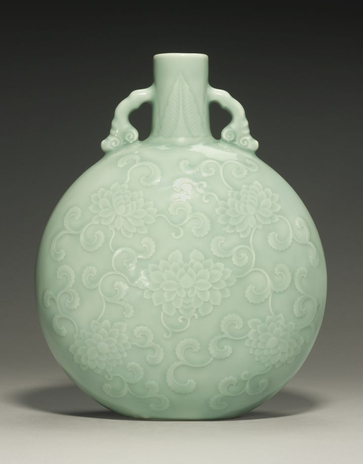A superb and rare finely carved celadon-glazed moon flask, Yongzheng seal mark and period