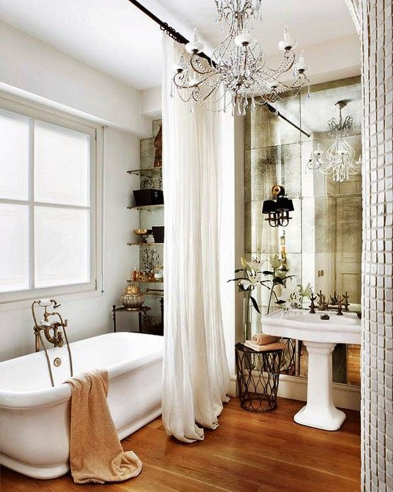 If you must use mirror paneling on a wall to reflect light and enlarge the space, antique mirrors add a sophisticated patina to this effect