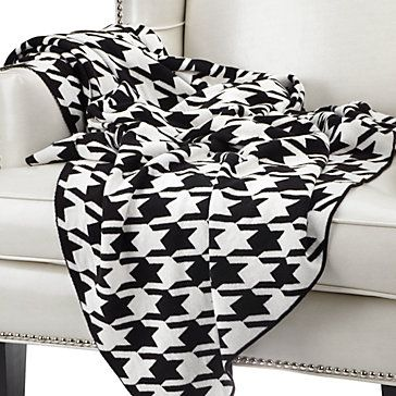 Add pattern & graphic interest to your space with our Houndstooth Throw.