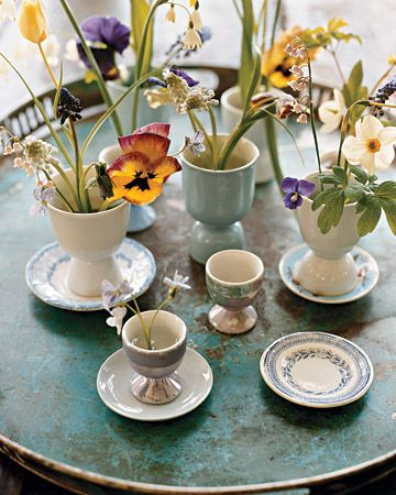 Last minute Decorating Idea! Spread out spring flowers across the Easter table by using eggcups as vases...Happy Easter!
