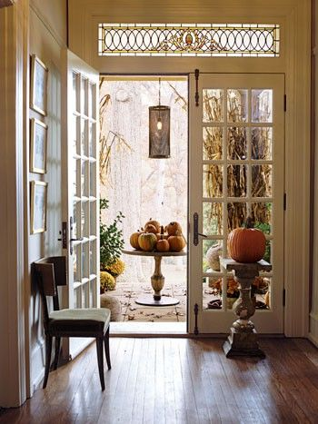 Welcoming entryway decorated for fall