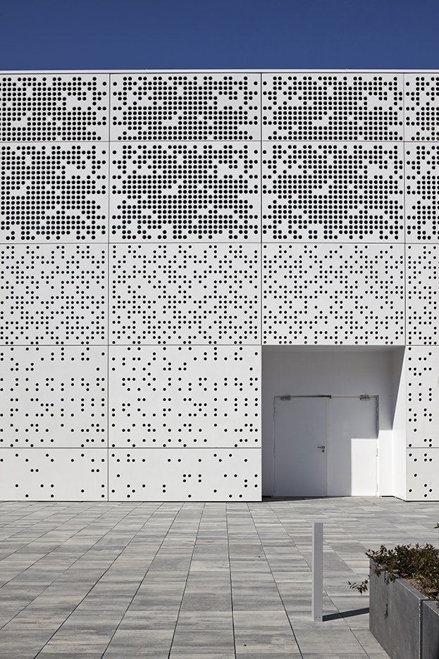 wednesday walls - a perforated façade