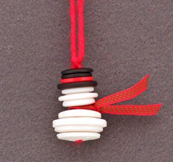 DIY BUTTON CRAFT~  Buttons, yarn, and a bit of ribbon is all you need for this adorable snowman ornament!