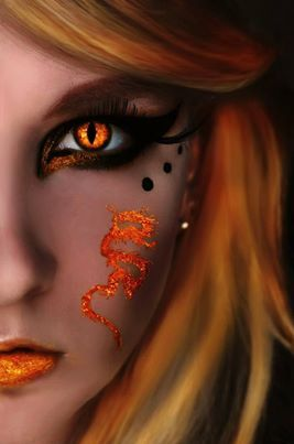 ~ Orange Eye ~ Fantasy. Love her face makeup too